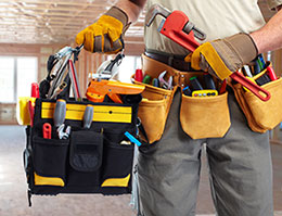 General Contractor Holding Tools